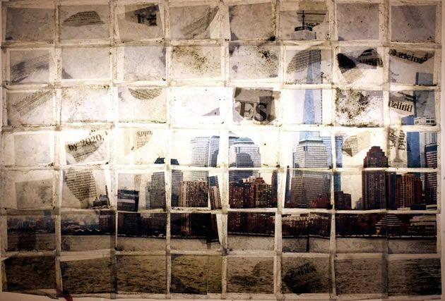 The piece above was made using the technique of wax-teabag trapping. A large image is cut into many smaller images and then placed into individual tea bags. The teabags are then glued together before an iron is used to melt wax onto the teabags to permanently seal them inside. This creates a fragmented image that has an unusual frail and distressed quality to it.