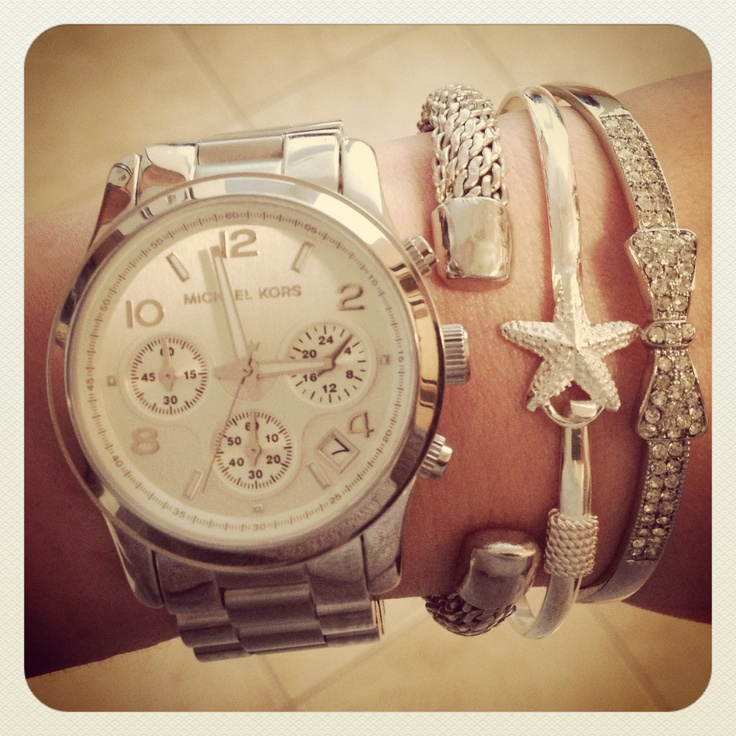 Michael Kors silver watch  I like the stack with the bangles! Yes please