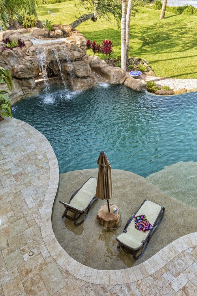 Pool Ideas backyard swimming pool with minimal decking deckjets and lounge chairs spa and pool 80 Fabulous Swimming Pools With Waterfalls Pictures