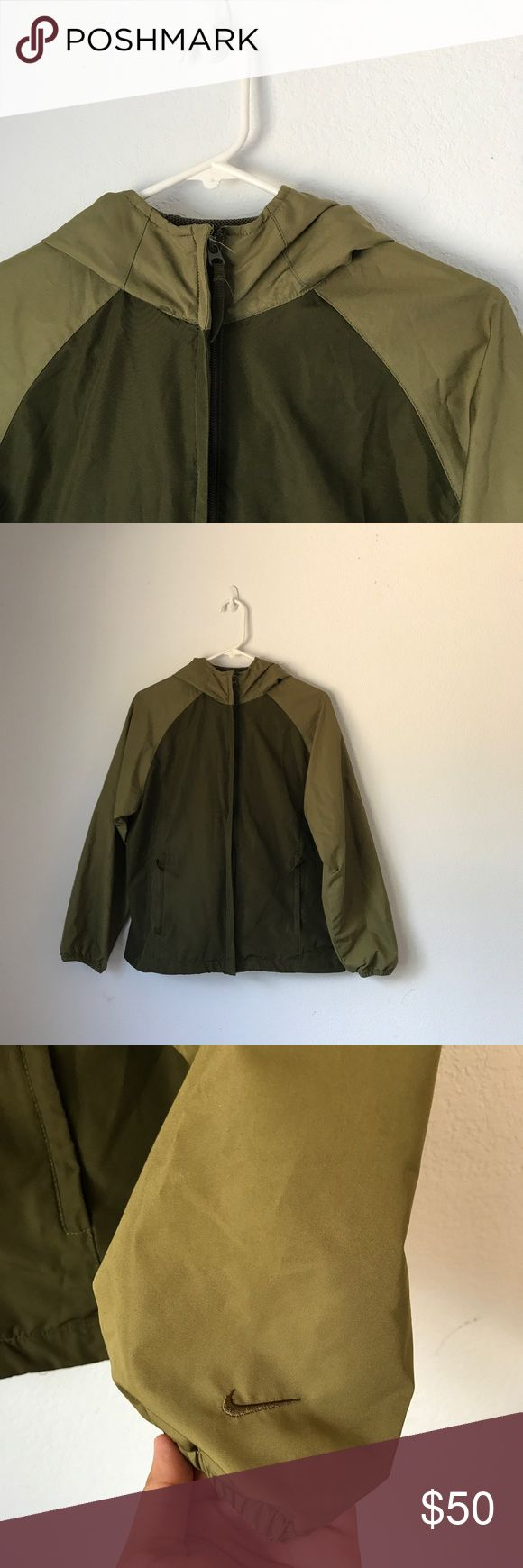 Nike Camo/Olive Green Windbreaker Fits M/L Accepting offers. No low ballers or trades. Small stain on hood. See last pic. Not noticeable. Size SMALL ON TAG in women's but FITS larger. Fits a medium loosely and a large fitted. Has a cap looking good. Very stylish. Pair with Nike sneakers and capris or shorts. Retail $110. Will take measurements if requested. Nike Jackets & Coats