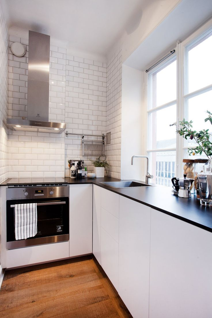 Small but stylish #kitchen in studio #apartment #decor #design #amazing #cool #white #tile #countertops #counter #cabinets #stove #hood #minimal #modern #Scandi #smallspace