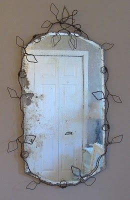 Love the way she formed this wire as a holder for the old mirror. Gorgeous!