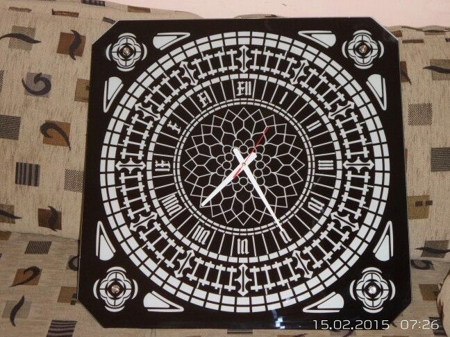 Wall clock made of 5 mm thick, black Lacobel glass.  Size 60 cm by 60 cm.