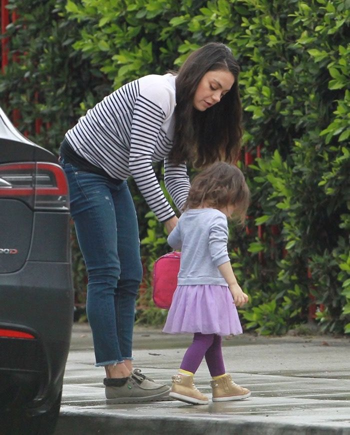 Mila Kunis was spotted taking her daughter Wyatt to daycare in Studio City, CA on Friday (Feb. 17).   The Bad Moms actress was dressed casually in a striped sweater, cut-off ankle jeans, and booties. She helped her daughter out of their car before passing the youngster a lunch bag.    In Decembe