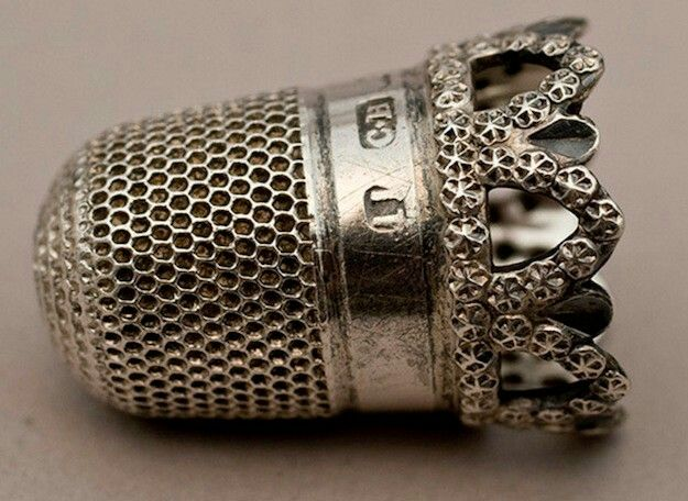 A beautiful hallmarked  thimble.