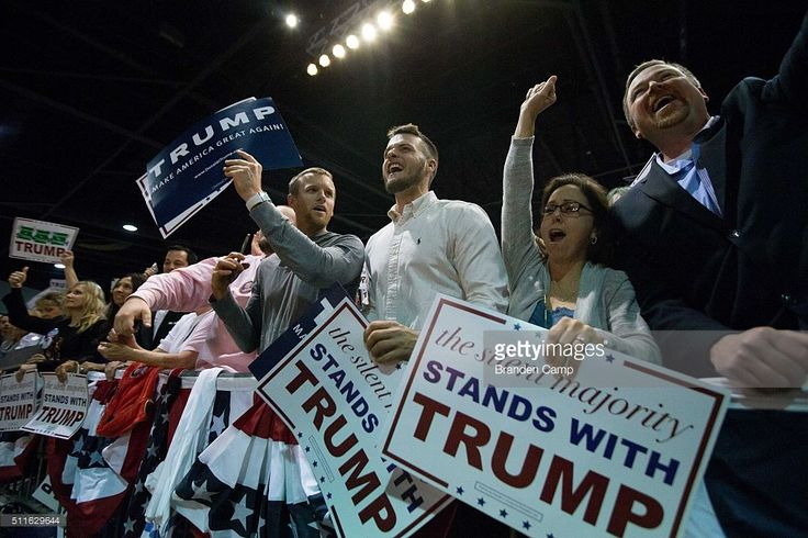 People cheer as Republican presidential candidate Donald Trump speaks during a campaign rally at the Georgia World Congress Center, February 21, 2016 in Atlanta, Georgia. Trump won the South Carolina Republican primary over nearest rivals Sen. Marco Rubio (R-FL) and Sen. Ted Cruz (R-TX).