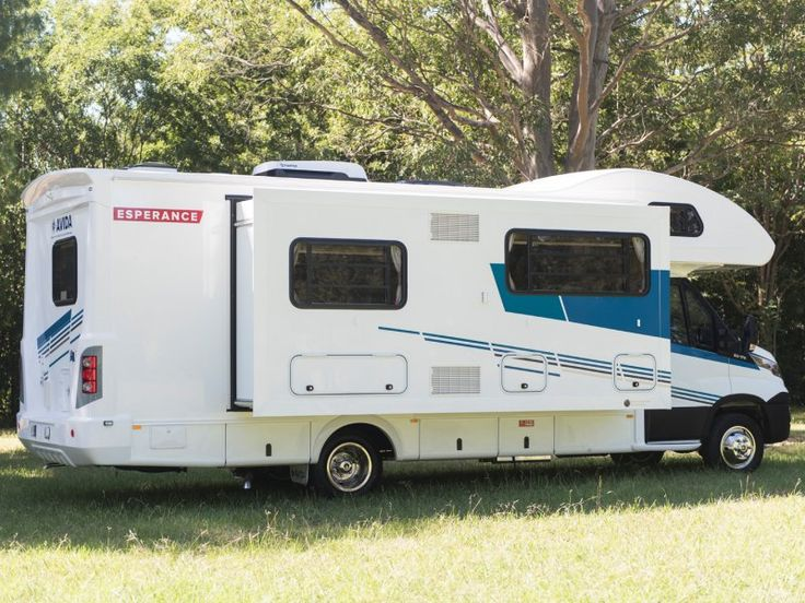 The slide out room is opened on this parked up Esperance C7923SL motorhome. This is a C Type motorhome because of the bed over the drivers cabin.