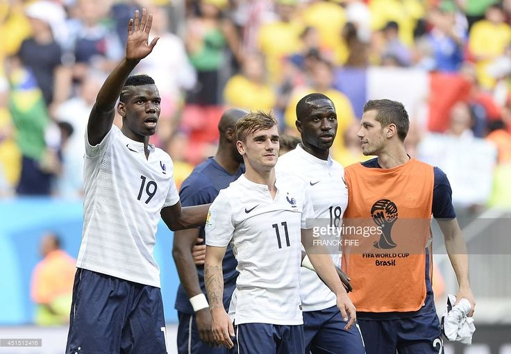 France's midfielder Paul Pogba, France's forward Antoine Griezmann, France's midfielder Moussa Sissoko and France's midfielder Morgan Schneiderlin celebrate at the end of the round of 16 football match between France and Nigeria at the Mane Garrincha National Stadium in Brasilia during the 2014 FIFA World Cup on June 30, 2014. France won 2-0.