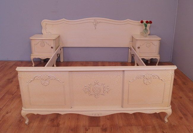 A very impressive shabby chic french double bed with bedside tables in Louis XV style Delicate carved, mounted on cabriole legs. Good condition, visible traces of normal use.  Amazing and unique set! 2 Bedside tables with doors Stunning bed without bed slat. Visible small defects in color.  Mattress base : 140cmx200cm   Dimensions: Bed Height: 9565cm Width:220cm Length:210cm  Bedside tables: Height:60cm Width:50cm Deepth:38cm
