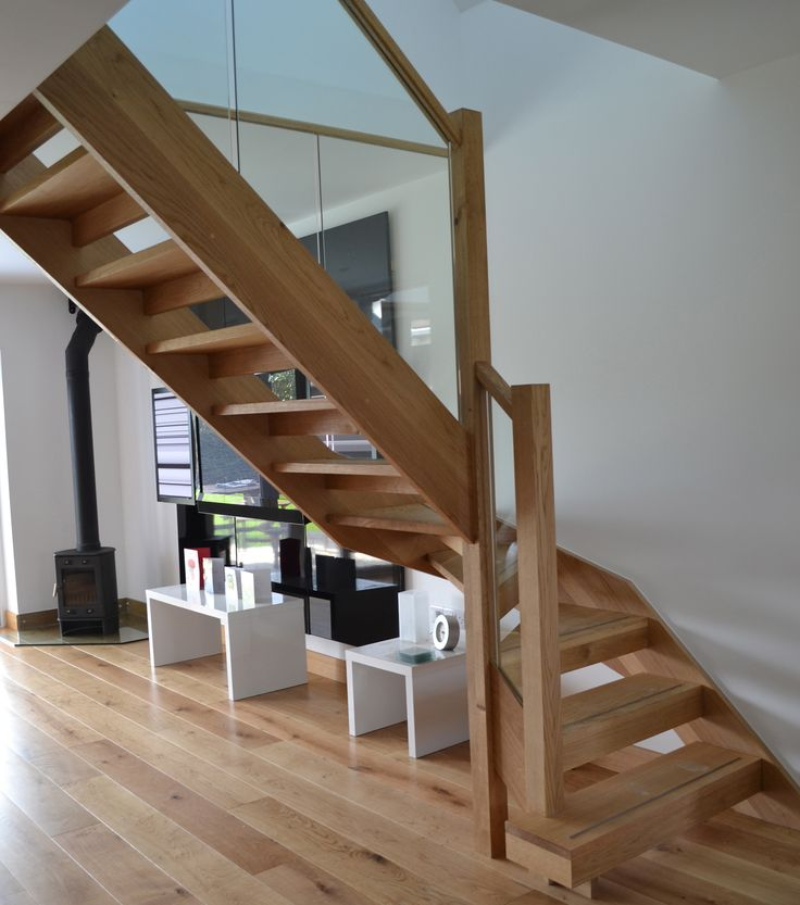 Beautiful oak stairs with glass bannister. Matching the materials of the staircase and the flooring has allowed the stairs to perfectly fit in this modern home.