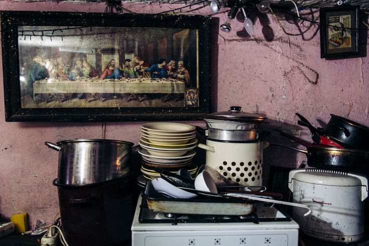 Washed dishes and a copy of Leonardo da VinciÕs painting ÒThe Last SupperÓ are seen in the tunnel. The tunnels inhabitants use generators to produce electricity for lights, fans, stereos, refrigerators and television.