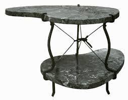 Carlo Mollino, tavolino con ripiani in marmo e struttura in metallo per CADMA, pezzo unico, 1947.