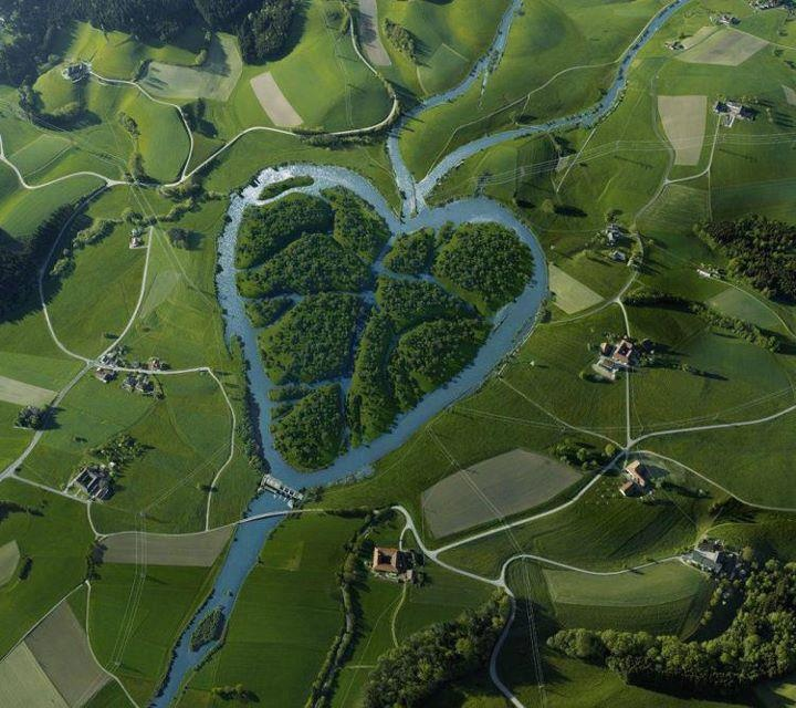 Fake - The river is real...The image of the heart is fake. - The Heart River is a tributary of the Missouri River, approximately 180 mi (290 km) long, in western North Dakota in the United States. The information on this image is at this link. http://viennapaint.com/work/archive.php   The image is not a real aerial photo. It was created for Energie AG by Andreas Fitzner and Sabine Wehinger from the Vienna Paint digital studio.