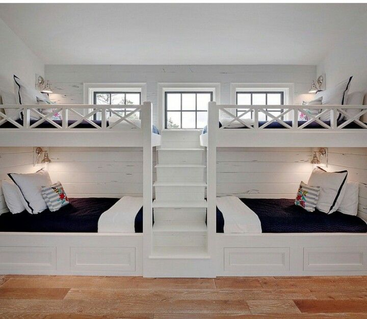 bunk beds with four twin beds this space would be comfortable for all ages and both boys and girls alike a navy and white color scheme is both classic and