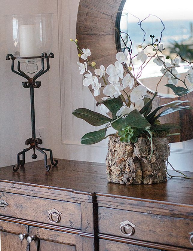 Dining Room Furniture Ideas. A closer look at the sideboard. I especially like the orchid arrangement – a mix of rustic with delicate. #DiningRoom #DiningRoomFurniture