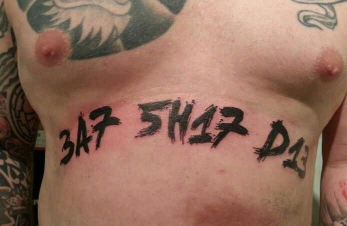 "Word tattoo ""eat shit die"" by Martin Nissl"