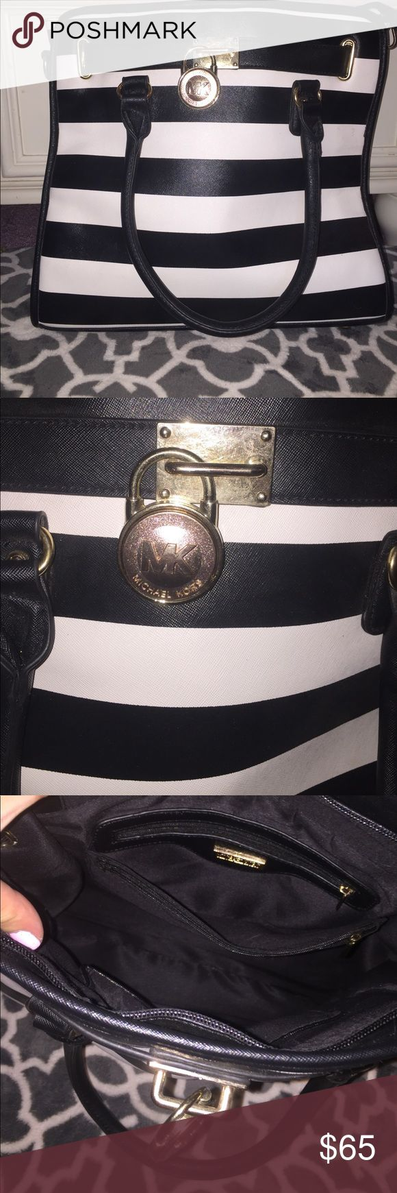 Quality imitation Michael Kors striped tote Brand new imitation Michael Kors tote bag, black and white stripes never used. Large gold lock on front, multiple pockets. Make me an offer😋 Michael Kors Bags Totes