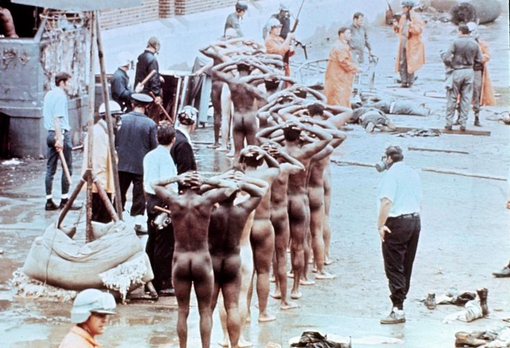 . EDS NOTE: NUDITY  Prisoners with their hands on their heads and stripped of all clothes are lined up after guards regained control following the Attica prison riot in Attica, New York, Sept. 1971. The riot, in which 43 were killed, lasted four days during which guards were held as hostages. (AP Photo)
