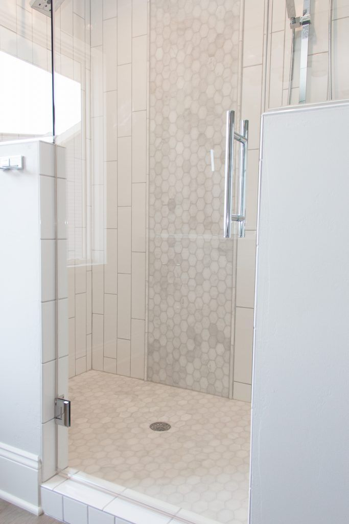 White Subway Tiled Shower With Hexagon Tile Accent Accent
