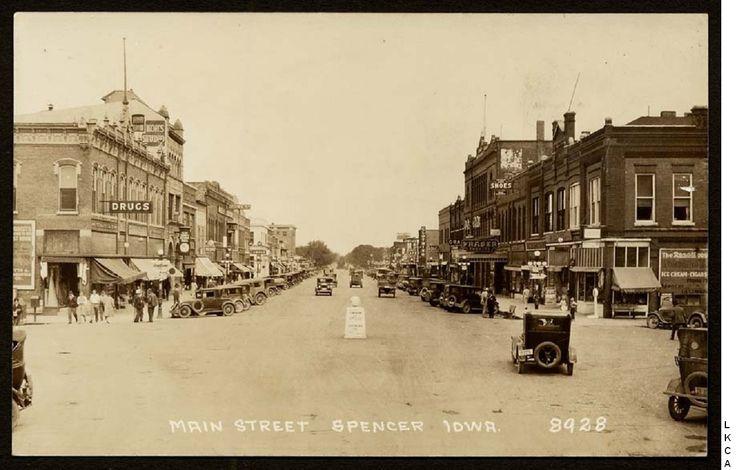 Real photo postcard of Main Street in Spencer, Iowa.
