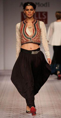 Designer : Anju Modi   Black Draped Trouser | Cream Gold Printed Inner | Red Emb Jacket | Black Corded Belt  That's a fierce look , Love it !