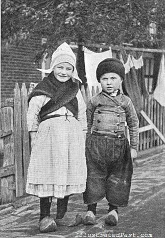 Two Dutch Children 1906. i remember when mom made me a dutch bonnet and yellow yarn braids to go with my wooden shoes for Halloween...