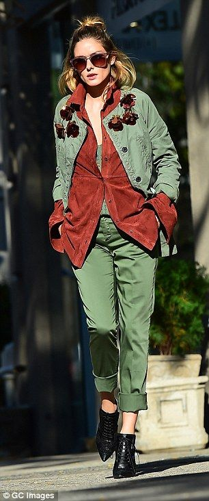 Khaki dream: Olivia wore a pair of silk green cropped trousers and a pair of high black leather boots