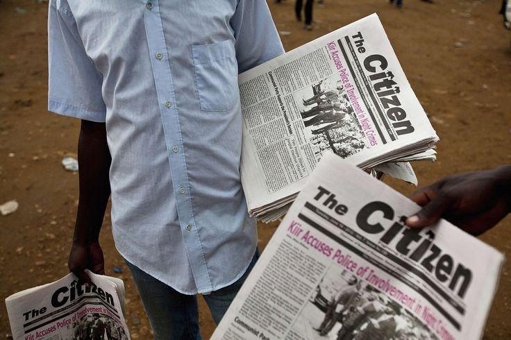 Newspaper vendors sell The Citizen newspaper at a bus station in Juba, June 19…