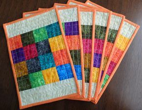 Quilted patchwork placemats, modern multicoloured mug rugs, dining decor, patchwork snack mats, cream, orange, reversible patchwork mats - pinned by pin4etsy.com