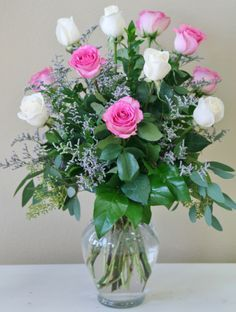 Dozen Roses including pink roses and white roses. Flowers by Willow Branch Florist of Riverside http://www.floristofriverside.com/  #Riversideflowers #Flowersriversideca #Riversidecaflowers #Flowers #Florist #Flowersriverside #Riversideflowershop