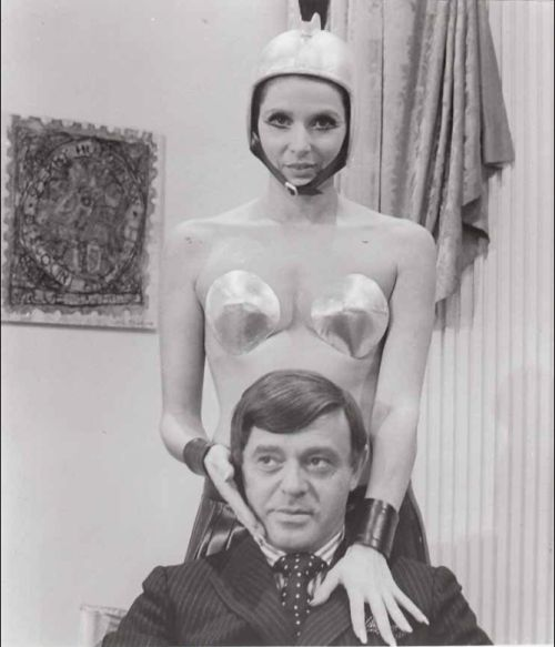 Rudi Gernreich and one of his models wearing a Gernreich costume for the Warner Bros. movie 2000 Years Later, 1969.