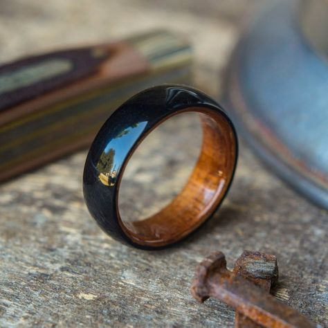 This bentwood ring is double-layered with a dark koa wood exterior, and lighter koa wood inside. The beautiful, rich koa grain is highlighted by a super high-po