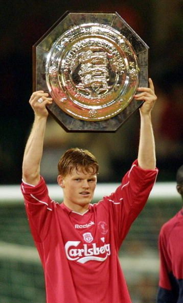 Liverpool's Norwegian summer signing John Arne Riise holds aloft the FA Charity Shield at The Millenium Stadium in Cardiff 12 August 2001 Liverpool...