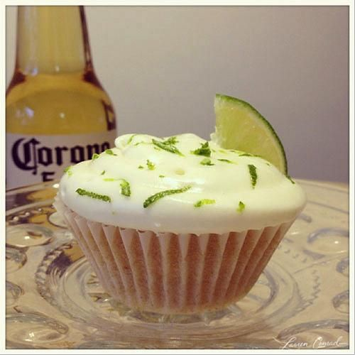 Corona Cupcakes  3/4 cups unsalted butter, room temperature  •1-3/4 cup sugar  •2-1/2 cup flour  •2 tsp baking powder  •1/2 tsp salt  •3 eggs, room temperature  •1 tsp vanilla  •1/2 tsp lime zest  •1 cup Corona beer, plus more for brushing on tops  •1/4 cup milk  •Lime wedges