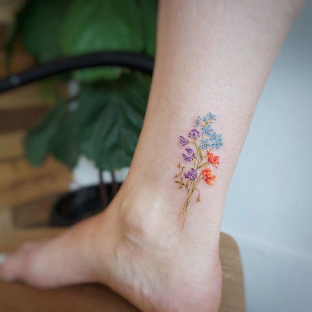Posy tattoo by Tattooist G. NO. #TattooistGNO #GNO #GNOtattoo #fineline #pastel #watercolor #microtattoo #flower #posy