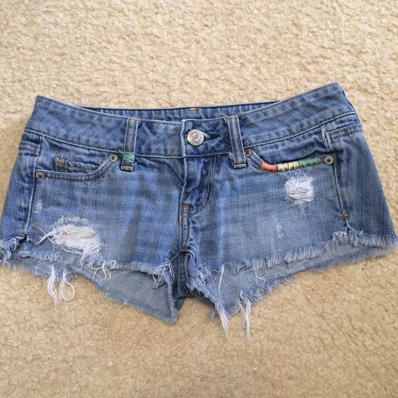 SALE American Eagle shorts American Eagle denim shorts. Size 00, would probably fit a 0 as well. Destroyed denim, light wash, with pastel colored stringing throughout (pictured.) very cute for summer and wearing to the beach! American Eagle Outfitters Shorts Jean Shorts