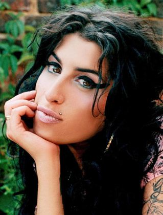 Amy Winehouse, British singer-songwriter whose 2006 Back To Black album earned her five 2008 Grammy Awards