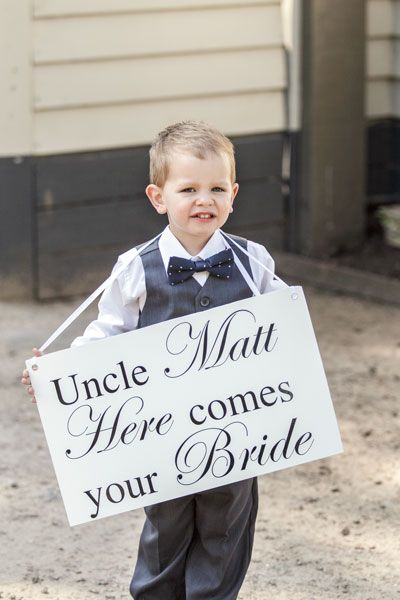 Kids love to be involved, and carrying an encouraging sign can be easier  than handling the wedding rings! Image: Sorrento Weddings.