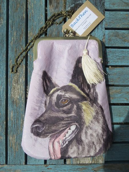 'Rover', a German shepherd dog, features on both the front and back of this bad.  This rare fabric is handpainted.