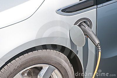 Hybrid electronic car connected to electronic power charger recharging the battery