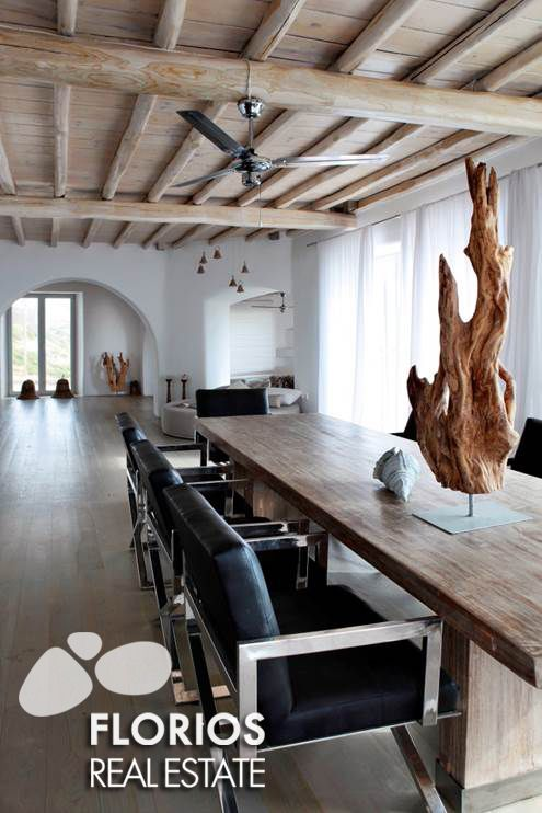 The very large open dinning room and sitting area with open fire place and a spacious kitchen with an extra guest WC and a wardrobe. FL1026 Two Villas for Sale on Mykonos island Greece. FL1026 http://www.florios.gr/en/mykonos-property/17.html
