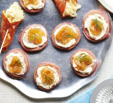 Top light, homemade blinis with cream cheese and smoked fish for a pretty and elegant canapé - a perfect party nibble
