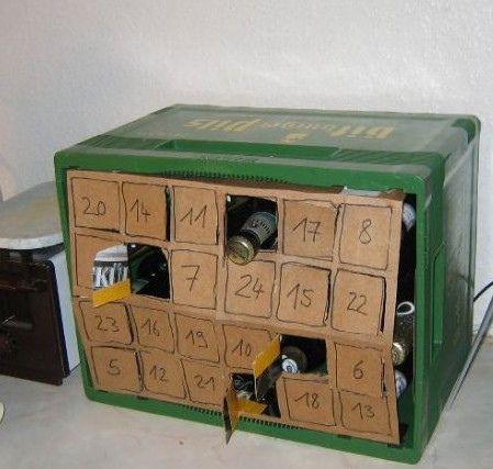 1. Buy different types of beer  2. Get an open wooden box with shelves. 3. Create advent doors from card board and attach. 4. Surprise your man!
