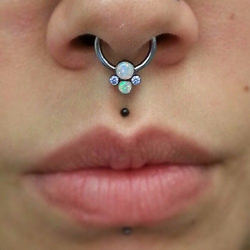 piercing: septum with opals, tiny black medusa, and rather discreet labret piercings... so lovely!