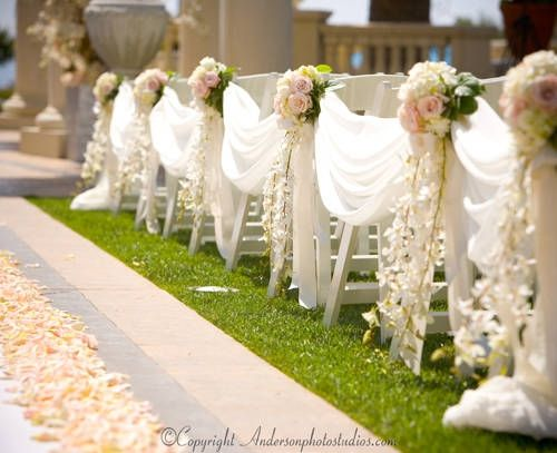 white dendrobium orchids draping down from half moon floral pieces make for a stunning entrance/ volusiacountyweddings/ www.callaraesfloralevents.com