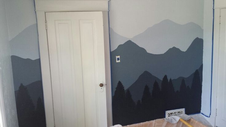 Completed mountain mural. Valspar Rising Tide (background and rest of room), Lighthouse Shadows, Magnet Dapple, Night View and New Black. Used half-pint Valspar samples to do the mountains.