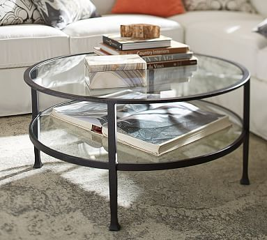 "$449.00 Tanner Round Coffee Table - Bronze finish #potterybarn 36"" diam x 18"" h Glass top and shelf make for easy display. Hand painted in a matte Iron Bronze finish."