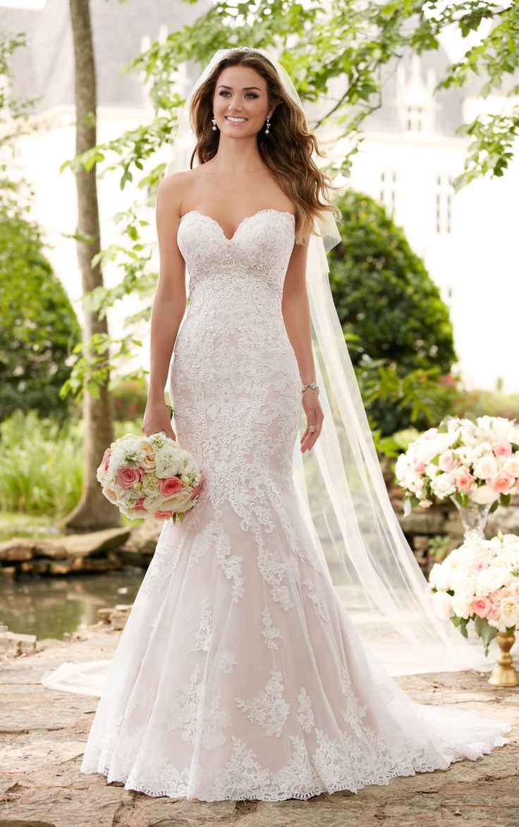 This romantic beaded wedding gown is a shimmering dress complete with a soft hourglass silhouette. Linear lace with a subtle empire shape accentuate curves.