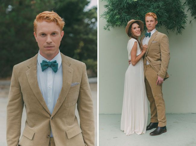 beige suit and teal bow tie