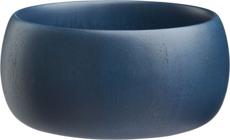 into the blue. A taste of Danish makes the rounds in an unexpected blue hue. Stained a deep indigo that reveals the natural beauty of rubber wood, Scandinavian-inspired serving bowl encircles a rounded, low-slung profile. Go blue in a big way with indigo wood serving bowl.